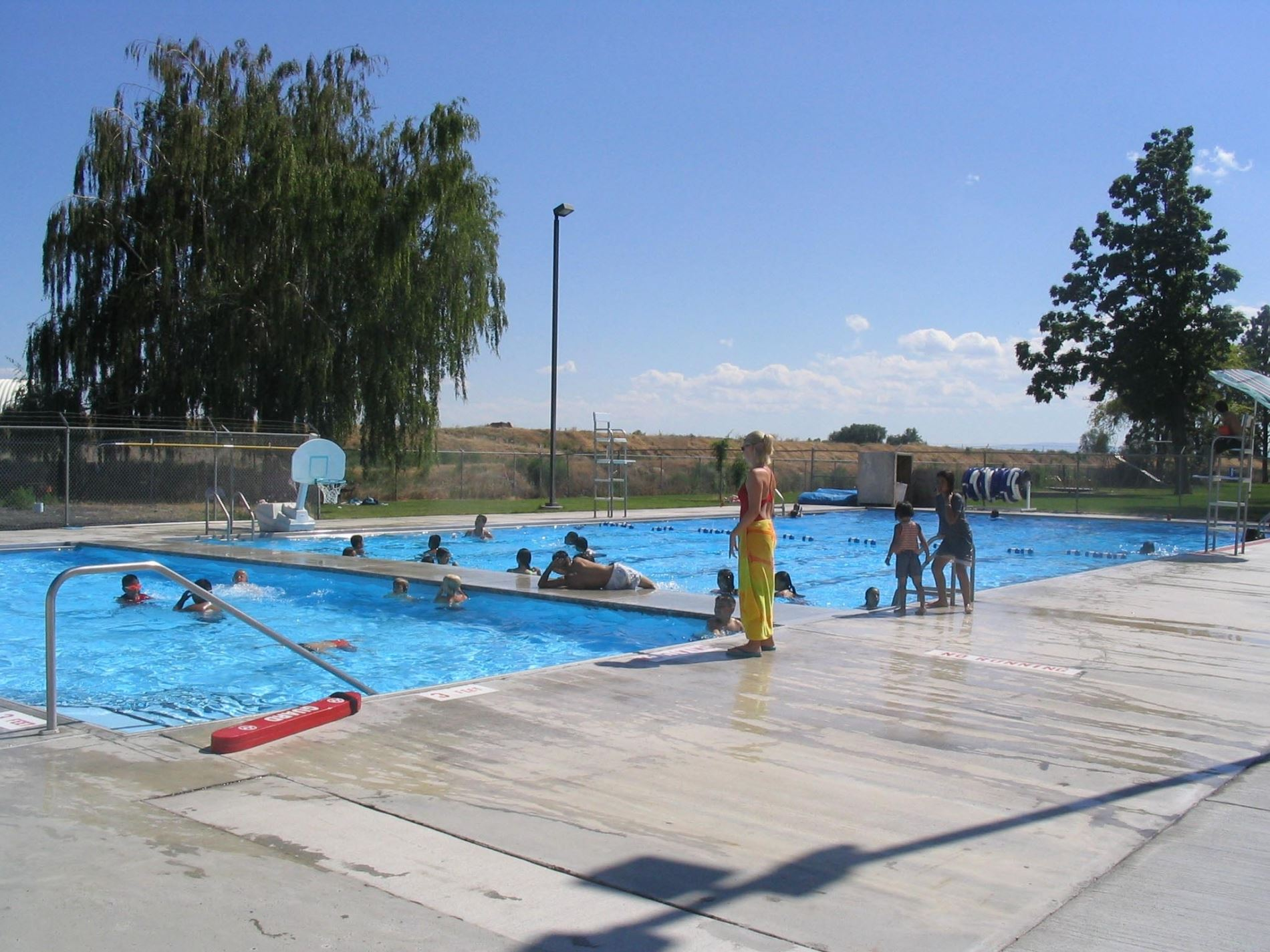 Divided pool with children playing in it
